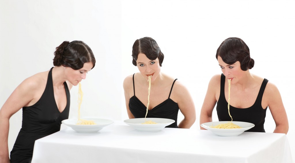 Portrait of a woman eating pasta
